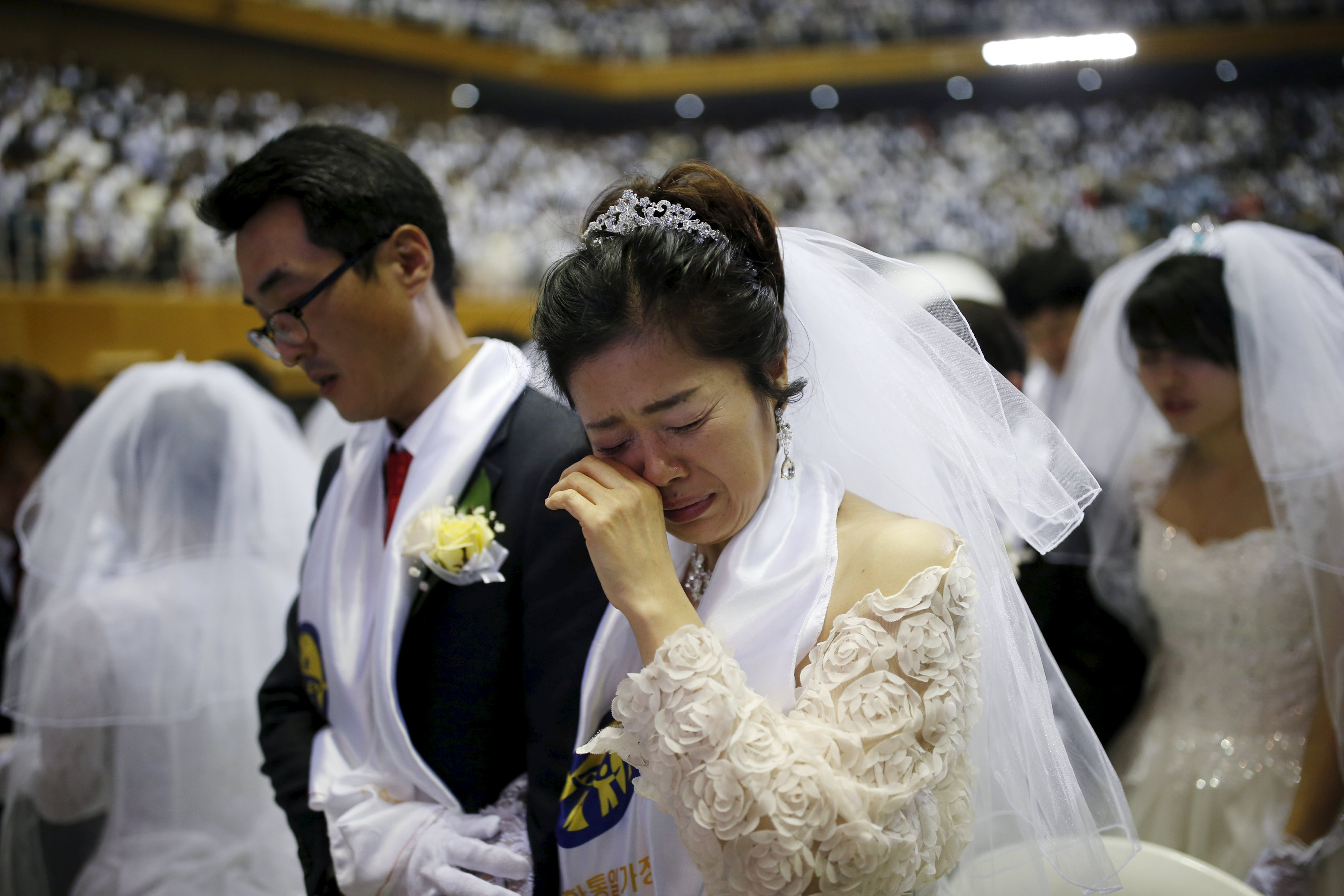 A bride cries during a mass wedding ceremony of the Unification Church at Cheongshim Peace World Centre in Gapyeong, South Korea, February 20, 2016. REUTERS/Kim Hong-Ji SOUTH KOREA-MASS WEDDING/