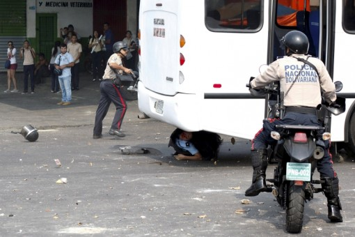 A police officer is run over by a bus during a protest against the increase in the price of public transport in San Cristobal