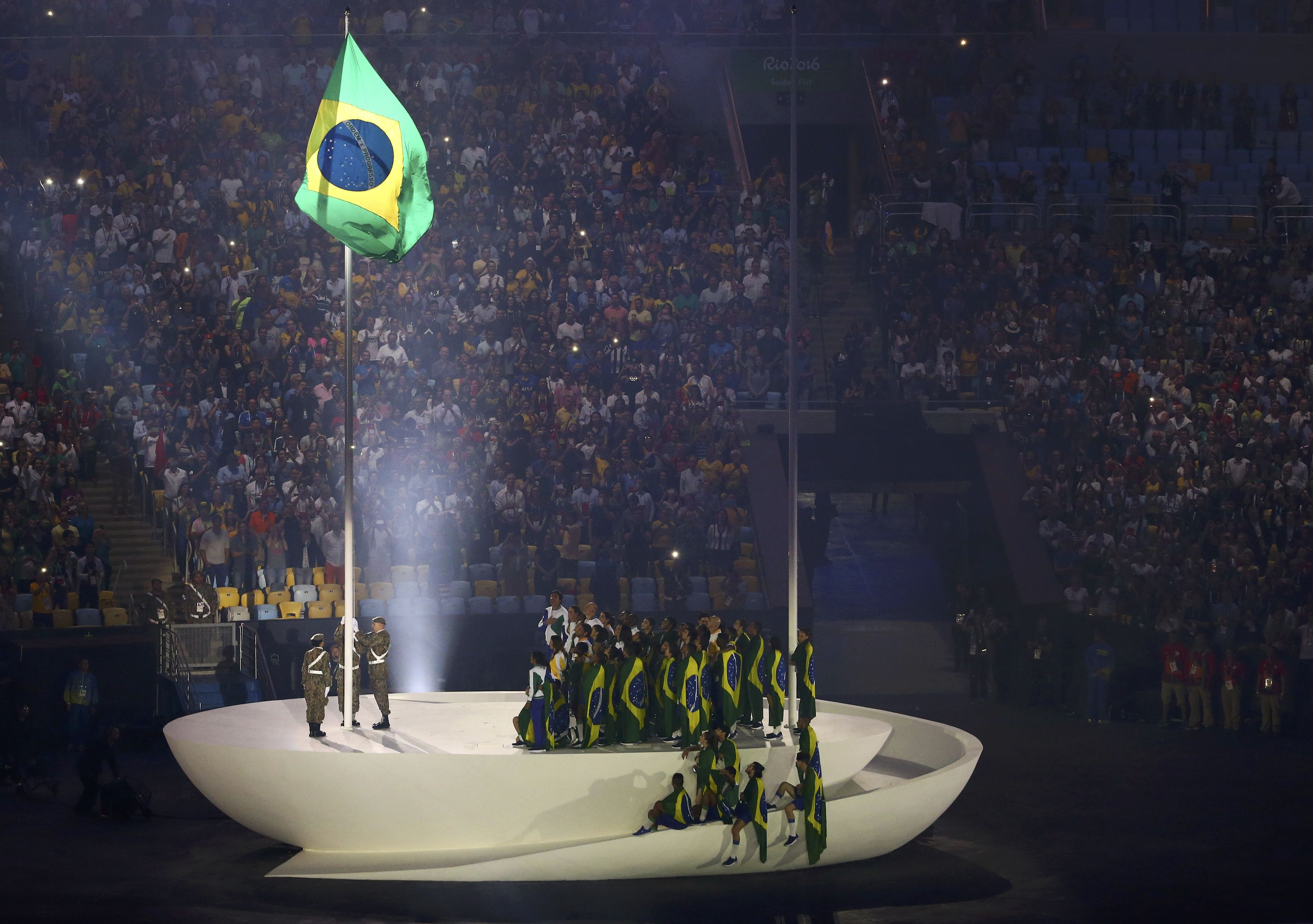 2016 Rio Olympics - Opening ceremony - Maracana - Rio de Janeiro, Brazil - 05/08/2016. The Brazilian national flag is raised during the opening ceremony. REUTERS/David Gray  FOR EDITORIAL USE ONLY. NOT FOR SALE FOR MARKETING OR ADVERTISING CAMPAIGNS.