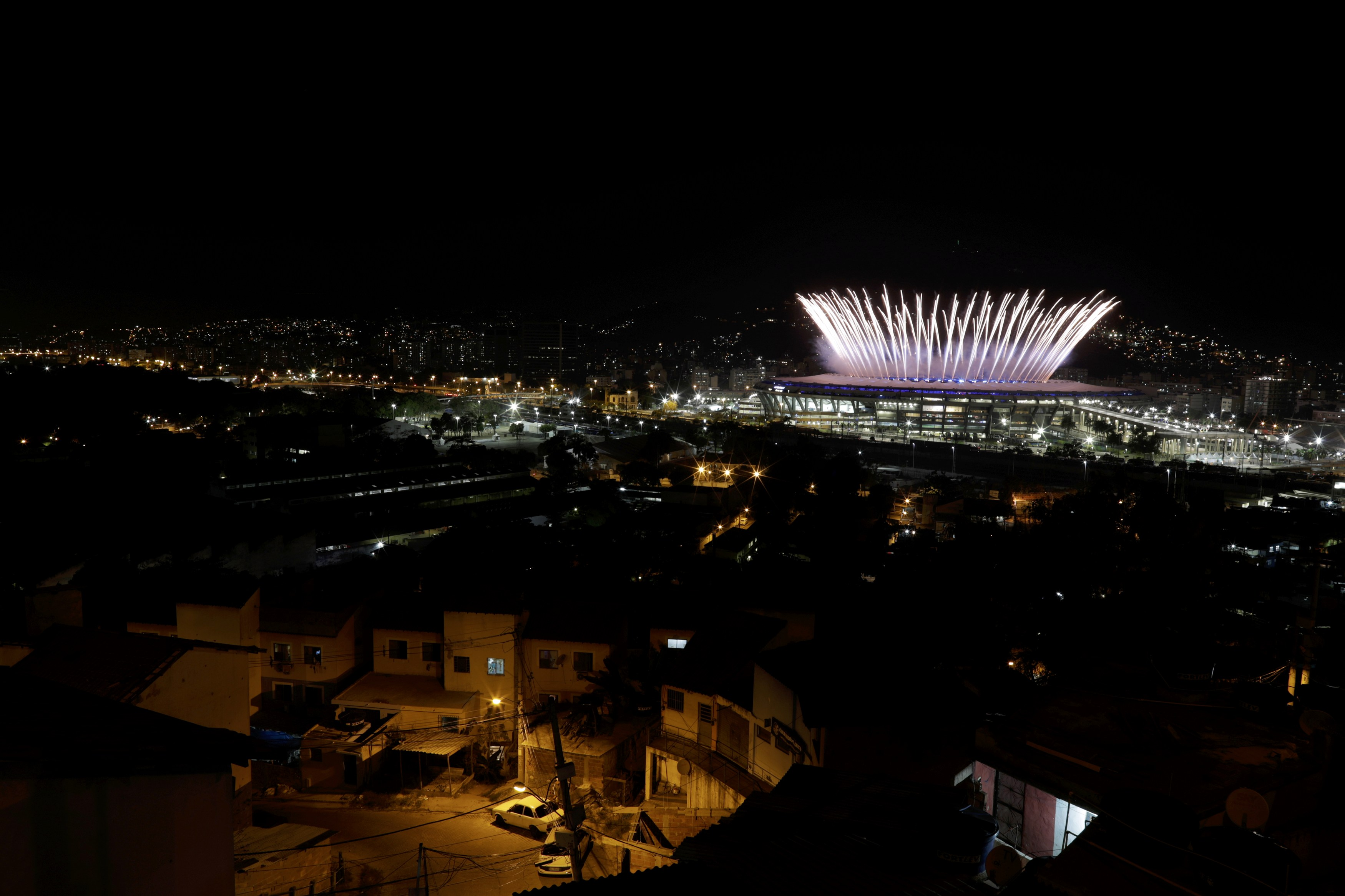 2016 Rio Olympics - Opening Ceremony - Maracana - Rio de Janeiro, Brazil - 05/08/2016. The Maracana Olympic Stadium during the opening ceremony is seen from the Mangueira favela slum. REUTERS/Ricardo Moraes TPX IMAGES OF THE DAY FOR EDITORIAL USE ONLY. NOT FOR SALE FOR MARKETING OR ADVERTISING CAMPAIGNS.