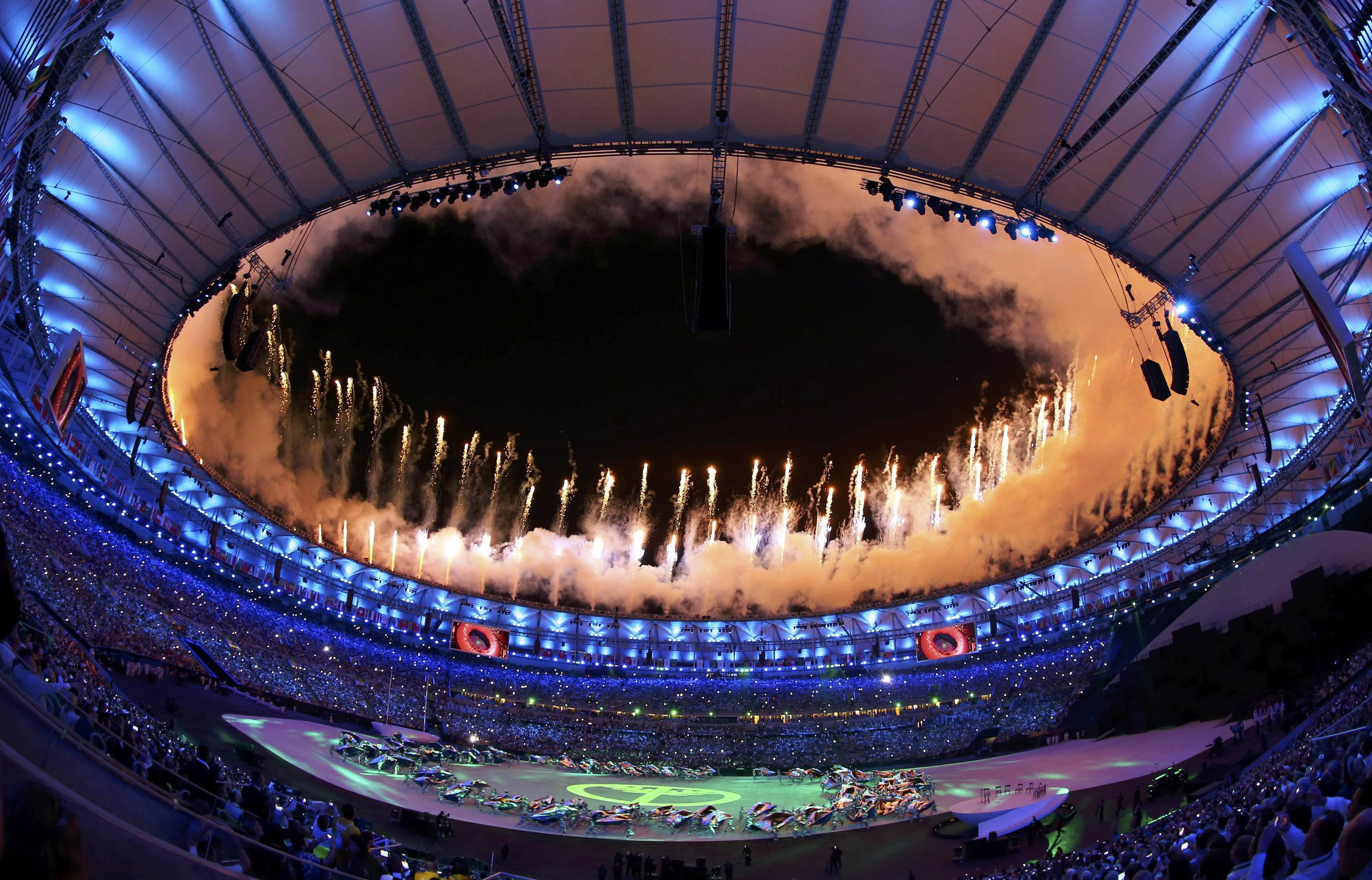 2016 Rio Olympics - Opening ceremony - Maracana - Rio de Janeiro, Brazil - 05/08/2016. Fireworks explode during the opening ceremony. Picture taken with a fisheye lens REUTERS/Ivan Alvarado FOR EDITORIAL USE ONLY. NOT FOR SALE FOR MARKETING OR ADVERTISING CAMPAIGNS