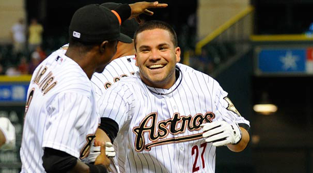 Houston Astros' Jose Altuve (27) is  congratulated by Luis Durango on his game-winning single in the 10th inning that gave the Astros a 4-3 over the Cincinnati Reds in a baseball game Monday, Aug. 1, 2011, in Houston. (AP Photo/Pat Sullivan)