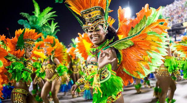 "RIO DE JANEIRO, BRAZIL - MARCH 03: Members of Vila Isabel samba school perform during its parade at 2014 Brazilian Carnival at Sapucai Sambadrome on March 03, 2014 in Rio de Janeiro, Brazil. Rio's two nights of Carnival parades begin on March 2 in a burst of fireworks and to the cheers of thousands of tourists and locals who have previously enjoyed street celebrations (known as ""blocos de rua"") all around the city. (Photo by Buda Mendes/Getty Images)"