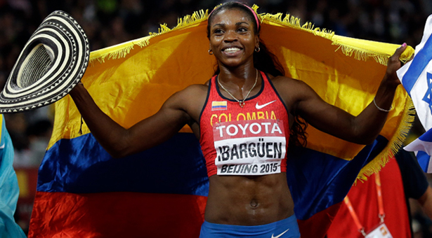 Colombia's Caterine Ibarguen celebrates after winning the women's triple jump final at the World Athletics Championships at the Bird's Nest stadium in Beijing, Monday, Aug. 24, 2015. (AP Photo/David J. Phillip)