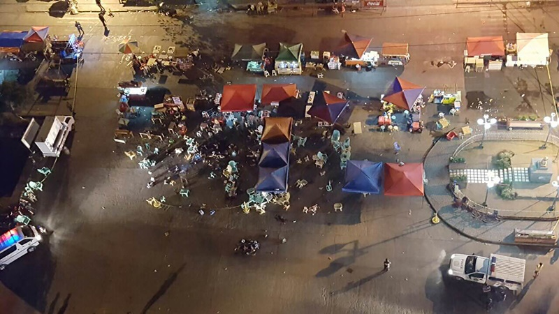 A photo taken from a mobile phone shows a general view of the site of an explosion at a night market in Davao City, in southern island of Mindanao, on late September 2, 2016. At least 10 people died and dozens were injured when an explosion rocked Philippine President Rodrigo Duterte's home city of Davao on September 2, 2016 night, police told AFP. The explosion occurred in a bustling part of the city and close to one of its top hotels that is popular with tourists and business people, city spokeswoman Catherine dela Rey said. / / AFP PHOTO / STRINGER