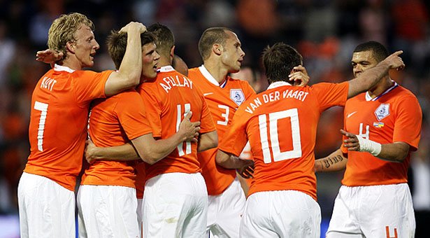 Dutch soccer player Klaas Jan Huntelaar, second from left, celebrates his goal against the Ukraine with teammates, during the International friendly soccer match between The Netherlands and the Ukraine at the Kuip stadium in Rotterdam, The Netherlands, Saturday May 24, 2008. (AP Photo/Bas Czerwinski)