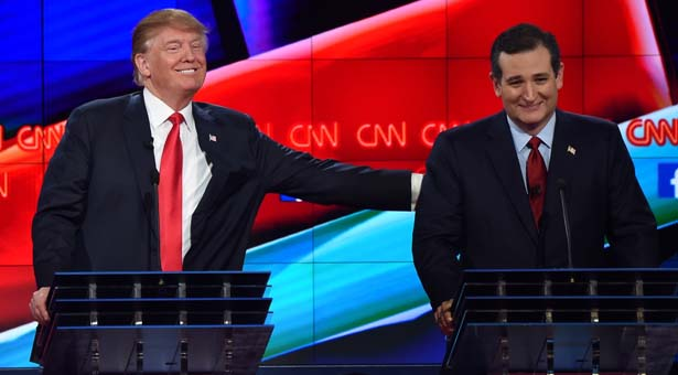 Republican presidential candidate businessman Donald Trump (L) pat the back of Texas Sen. Ted Cruz during the Republican Presidential Debate, hosted by CNN, at The Venetian Las Vegas on December 15, 2015 in Las Vegas, Nevada. AFP PHOTO/ ROBYN BECKROBYN BECK/AFP/Getty Images